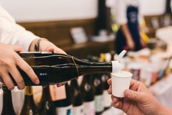 pouring a glass of Japanese sake or nihonshu